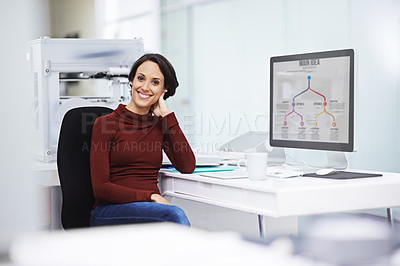 Buy stock photo Portrait of a happy young businesswoman sitting by her computer in the office