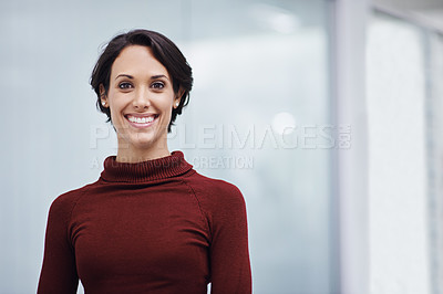 Buy stock photo Portrait of a confident young businesswoman in her office