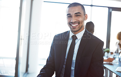 Buy stock photo Portrait of a confident young businessman in a meeting at work
