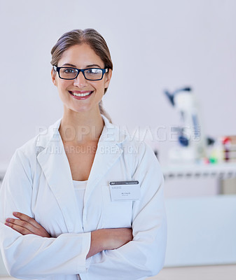 Buy stock photo Portrait of a smiling scientist standing in a laboratory