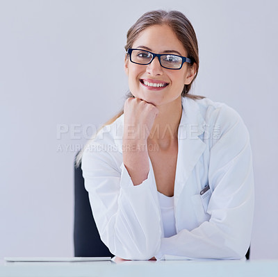 Buy stock photo Portrait of a smiling scientist sitting at a desk