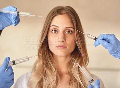 Buy stock photo Portrait of a young woman with needles pointed around at her face