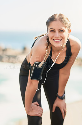 Buy stock photo Portrait of an attractive young woman smiling after her morning run