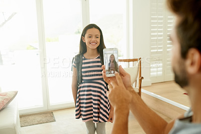 Buy stock photo Shot of a little girl posing as her father takes a picture of her
