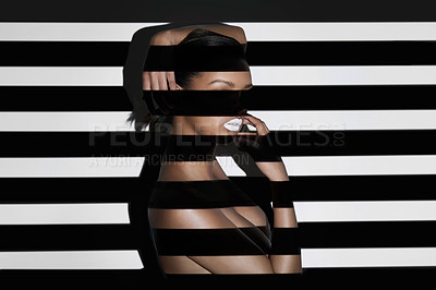 Buy stock photo Digitally enhanced shot of a beautiful nude woman posing alone in studio