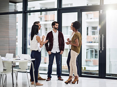 Buy stock photo Shot of a group of businesspeople having a discussion in a modern office