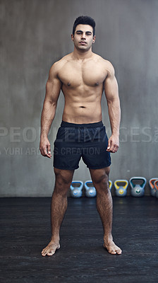 Buy stock photo Portrait of a handsome young man standing shirtless in the gym