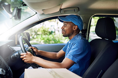 Buy stock photo Shot of a young postal working sitting in his car during a delivery