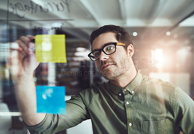 Buy stock photo Cropped shot of a young male designer planning on a glass board