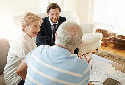 Buy stock photo Shot of a senior couple getting advice from their financial consultant in their living room