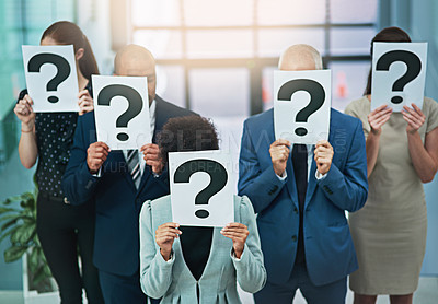 Buy stock photo Cropped shot of a group of businesspeople holding placards with question marks in front of their faces