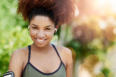 Buy stock photo Cropped shot of a young woman out for a run