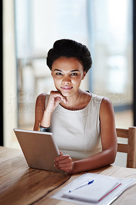 Buy stock photo Portrait of a smiling young businesswoman using a digital tablet in an office