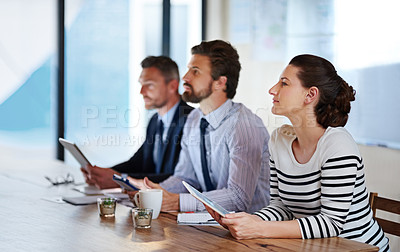 Buy stock photo Shot of a group of colleagues listening to a presentation in an office