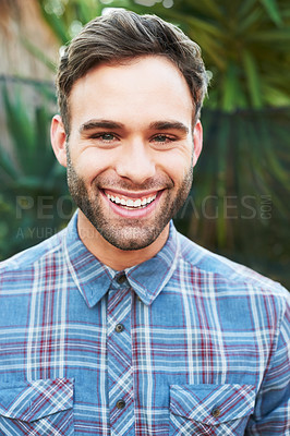 Buy stock photo Cropped portrait of a handsome young man standing outside