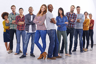Buy stock photo Full length studio of a group of happy people wearing casual clothes
