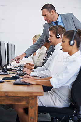 Buy stock photo Cropped shot of people working in a call center