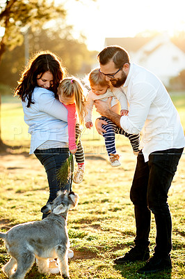 Buy stock photo Shot of a family of four enjoying a sunny day at the park