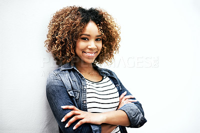 Buy stock photo Portrait of a young woman posing with her arms crossed against a white background