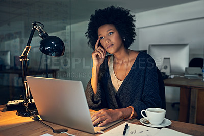 Buy stock photo Cropped shot of a young businesswoman working late on a laptop in an office