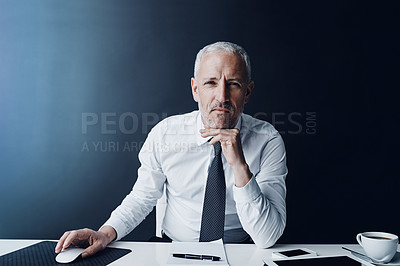 Buy stock photo Cropped portrait of a mature businessman working on his computer