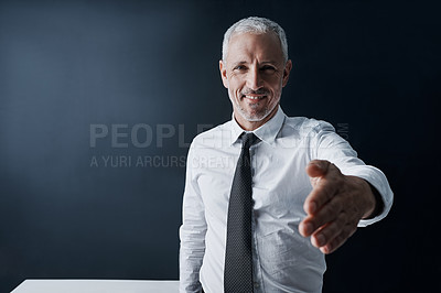 Buy stock photo Cropped portrait of a mature businessman offering you his hand of agreement