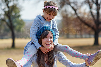 Buy stock photo Cropped shot of a mother and daughter bonding together at the park