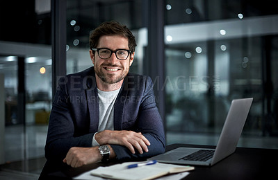 Buy stock photo Portrait of a happy young businessman working at his office desk