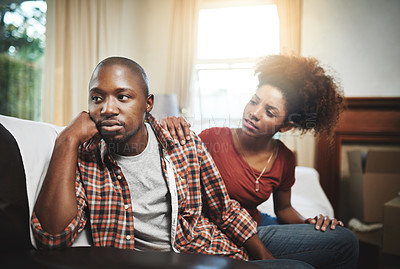 Buy stock photo Cropped shot of a young couple having relationship problems at home