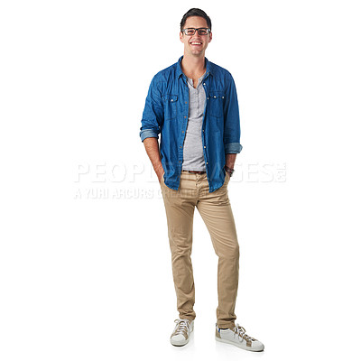 Buy stock photo Studio portrait of a handsome young man standing with his hands in his pockets isolated on white