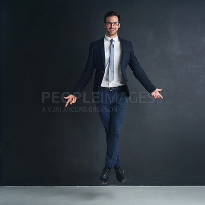 Buy stock photo Studio portrait of a businessman in mid air while ballet dancing