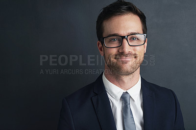 Buy stock photo Studio portrait of a smiling businessman in a suit and glasses