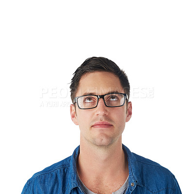 Buy stock photo Studio shot of a young man looking up at copyspace isolated on white