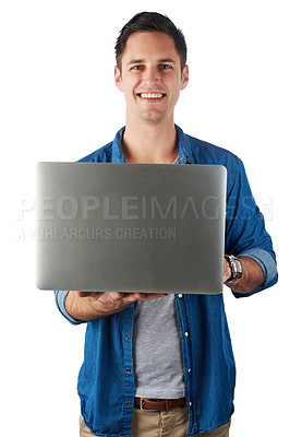Buy stock photo Studio portrait of a handsome young man holding a laptop isolated on white