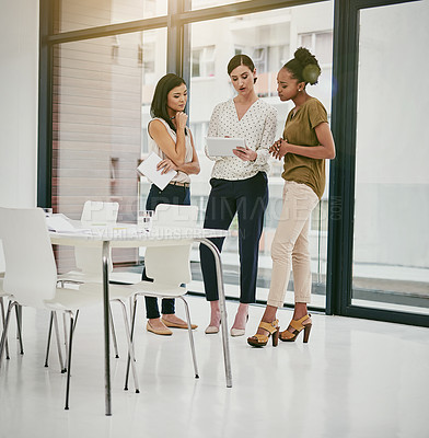 Buy stock photo Shot of a group of colleagues having a meeting in a modern office