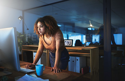 Buy stock photo Shot of a young woman working late in an empty office