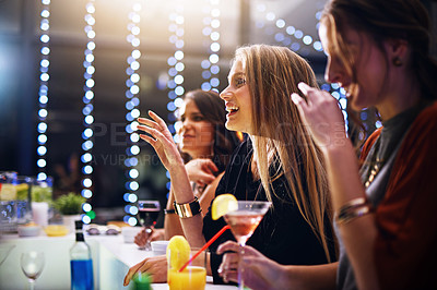 Buy stock photo Cropped shot of a group of friends having drinks together at a party