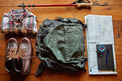 Buy stock photo Shot of hiking gear arranged on a table