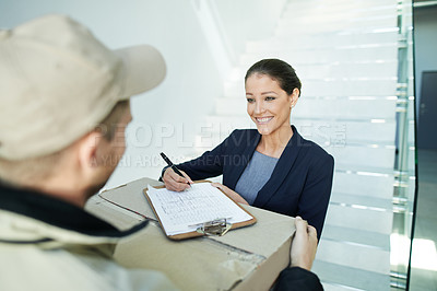 Buy stock photo Shot of a businesswoman receiving a package from a deliveryman in the office