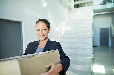Buy stock photo Portrait of a businesswoman receiving a package in the office