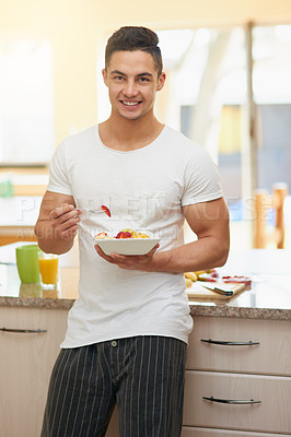 Buy stock photo Cropped shot of a young man eating a fruit salad