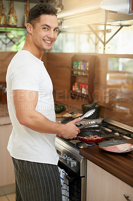 Buy stock photo Cropped shot of a young man preparing breakfast at home