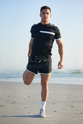 Buy stock photo Full length portrait of a handsome young man warming up before a workout on the beach