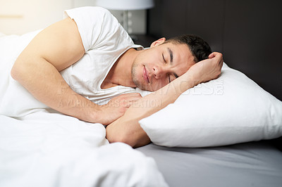 Buy stock photo Cropped shot of a handsome young man asleep in his bed0