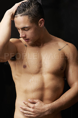 Buy stock photo Shot of a handsome young man having a refreshing shower at home
