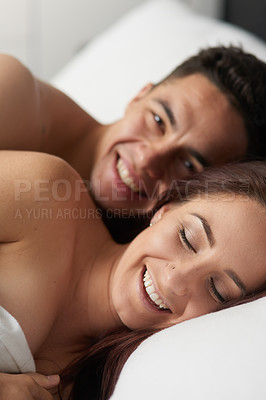 Buy stock photo Shot of a happy young couple in bed together