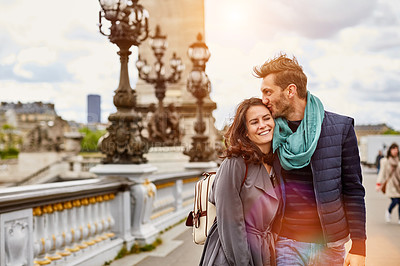Buy stock photo Shot of a smiling young couple walking together in the streets of Paris