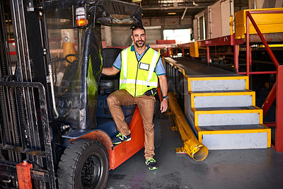Buy stock photo Portrait of smiling forklift operator standing in a large warehouse