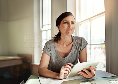 Buy stock photo Cropped shot of an attractive young designer working over a drafting table