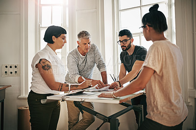 Buy stock photo Cropped shot of a team of designers brainstorming together in an office